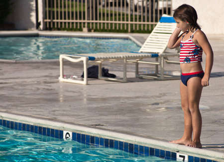 A close up of a young girl on a summer day in the pool.