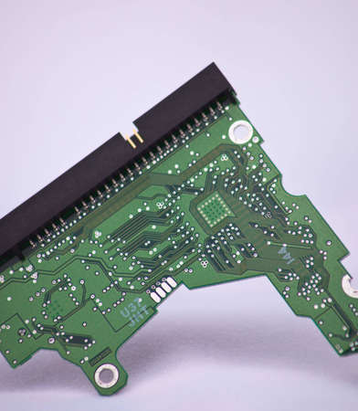 A close up of a mother board for a hard drive. photo
