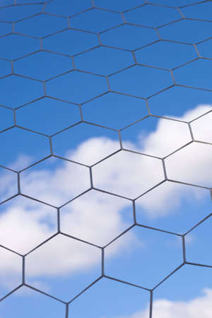 A shot of a soccer net with a cloudy blue sky in the background. Stock Photo - 5748807