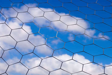 A shot of a soccer net with a cloudy blue sky in the background. Stock Photo - 5748805