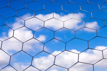 A shot of a soccer net with a cloudy blue sky in the background. Stock Photo - 5748806