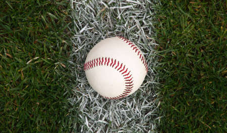 A close up of a baseball sitting on the foul line. Stock Photo - 6328187