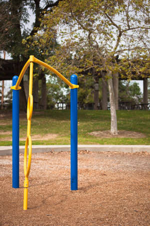 A shot of yellow and blue playground equipment. photo