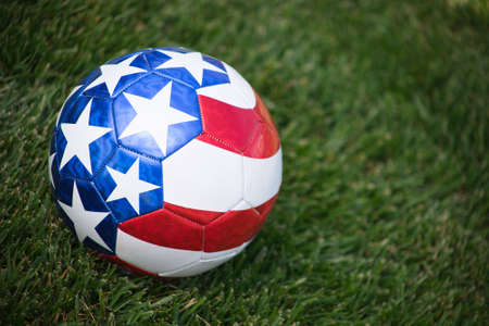 A close up of a stars and stripes soccer ball on grass. Stock Photo - 6646534