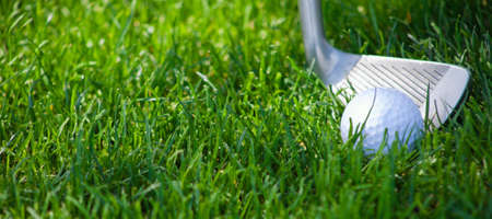 A close up of a golf club chipping a golf ball out of deep green rough. Banque d'images - 6788736