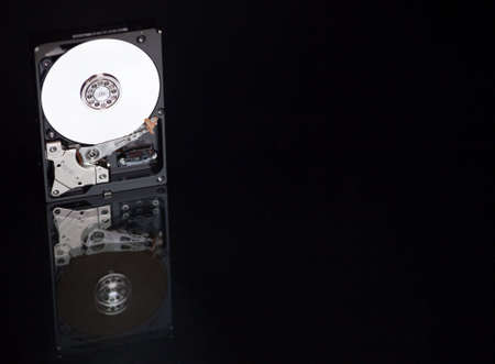 A close up of a computer hard drive with a black background. photo
