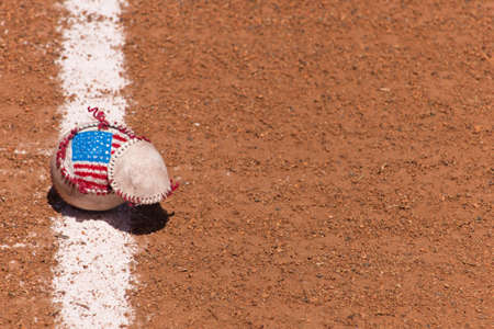 A close up of a torn baseball with a hand painted American Flag. Stock Photo - 7071673