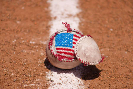 A close up of a torn baseball with a hand painted American Flag. Stock Photo - 7071657