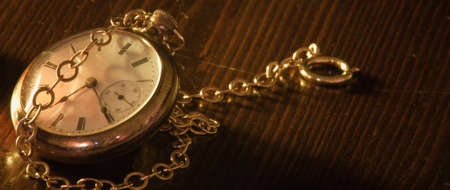 A close up of a pocket watch.