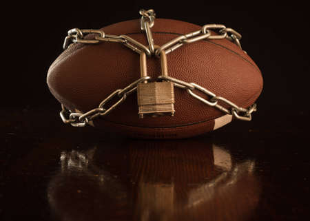 locked up: A close up of a football locked up with chain.