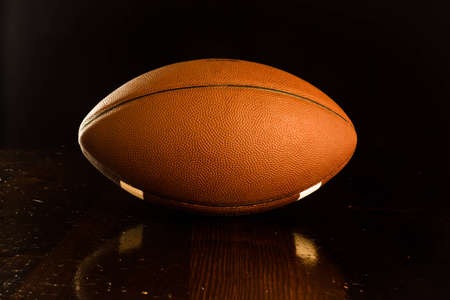 A close up of a footbal on a wood table. Stock Photo - 9388188