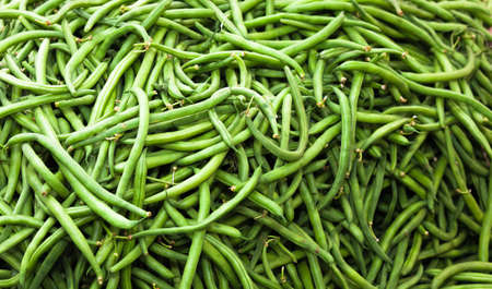 A close up of a large pile of string Beans.