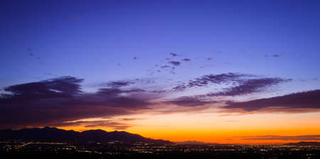 A wide shot looking out over Salt Lake City during a summer sunset.