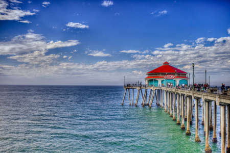 A shot looking down Huntington Beach Pier on a bright sunny labor day. Stock Photo