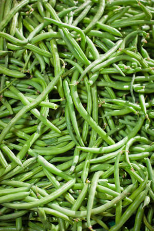 A close up of a big pile of string green beans. photo