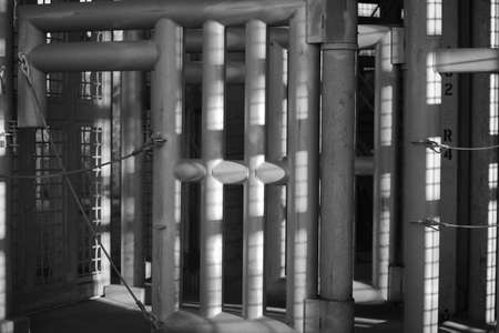 lockdown: A black and white shot of a large steel cage for animals. Stock Photo