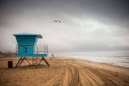 A shot of a life guard tower during a storm in Huntington Beach. Stock Photo