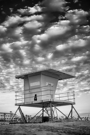 A close up shot of a life guard tower in Huntington Beach with a cloudy blue sky. Banque d'images