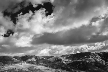 A black and whie wide shot of rolling hills