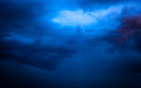 A wide night shot of storm clouds just before a lighting strike