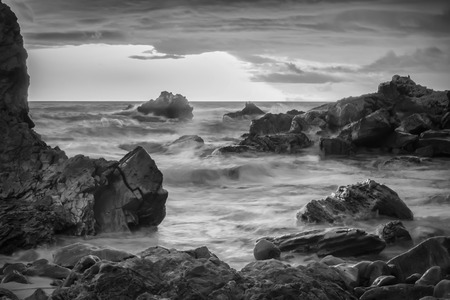 A black and white shot looking out to the Pacific Ocean.