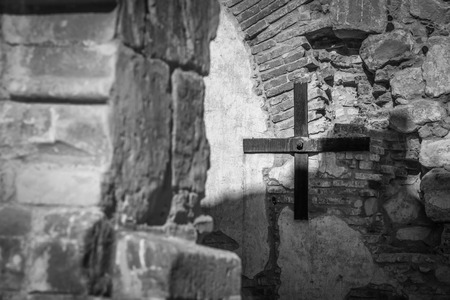 A black and white shot of an old iron cross just outside the old Mission at San Juan Capistrano.