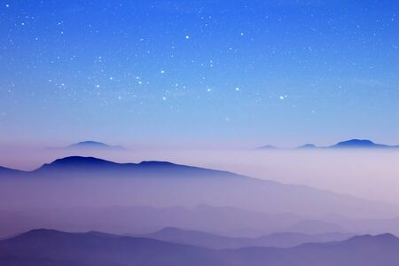 morning mist mountain and starry sky Stock Photo - 10322675