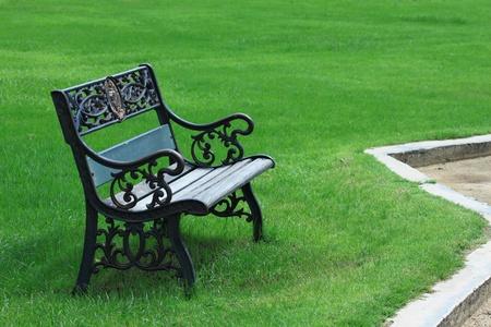 holidays vacancy: metal garden chair on green grass