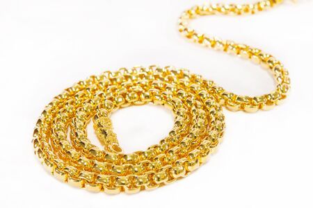 golden necklace on white background
