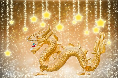christmas dragon: golden dragon on abstract stars background  Stock Photo