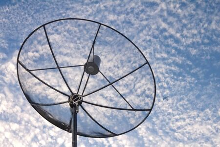 satellite dish with cloud sky photo