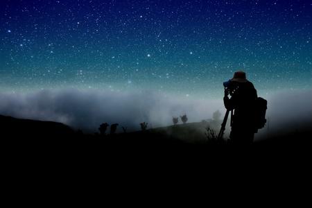 'starry night': silhouette of photographer shooting night stars
