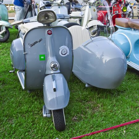 BANGKOK ; MARCH 17 : Vintage Vespa Scooter on pisplay at The Royal Bangkok Sports Club, To Celebrate Vespa 65th Anniversary Party on MAR. 17,2012,Thailand.