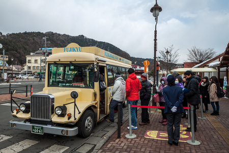 sight seeing: FUJIKAWAGUCHIKO, JAPAN - February 9, 2016: Local Sight Seeing Bus parking for tourist at the Kawaguchiko station.