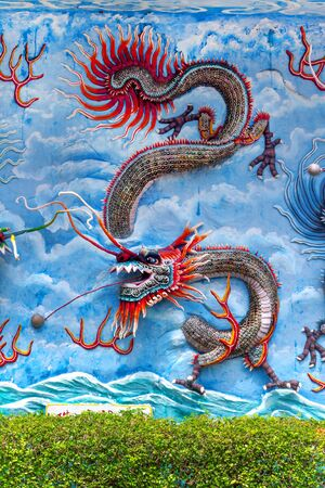 par: SINGAPORE - AUG. 7 , 2016 : Haw Par Villa or Tiger Balm Garden is a theme park contains over 1,000 statues and 150 giant dioramas depicting scenes from Chinese mythology, folklore, legends, history. Located in  Pasir Panjang Road, Singapore.
