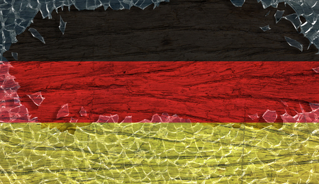Germany flag on wooden texture in broken glass frame, vintage style Stock Photo