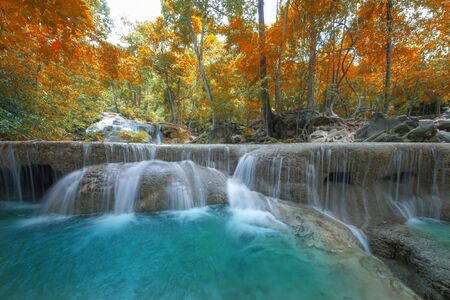 smooth: beautiful waterfall in the deep forest, Erawan waterfall national park, Thailand Stock Photo