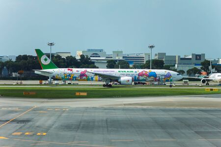 SINGAPORE - AUG. 8 ,2016 : EVA AIR Boeing 777-36N ER ( Hello Kitty Shining Star Livery ) landing in Changi airport, Singapore.One of the most adorable Sanrio Character special livery on the flagship of Eva Air.