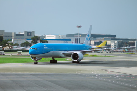 SINGAPORE - AUG. 9 ,2016 : KLM Boeing 777 landing in Changi Airport, Singapore. KLM is the flag carrier airline of the Netherlands.