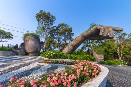 Da Nang, Vietnam - Mar. 29, 2019: Giants sculpture in the garden on Ba Na Hills french village, Ba Na Hills mountain resort is a favorite destination for tourists. 報道画像