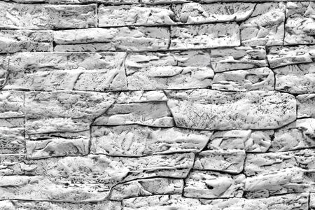 Modern black and white stone wall texture background.