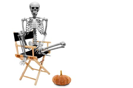 Fake human skeleton sitting on director chair isolated on white background.halloween concept. 写真素材