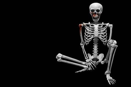 Fake human skeleton sitting on black background