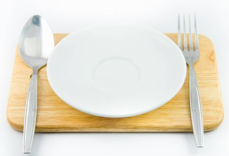 Spoon , fork , dish with white backgrounds photo