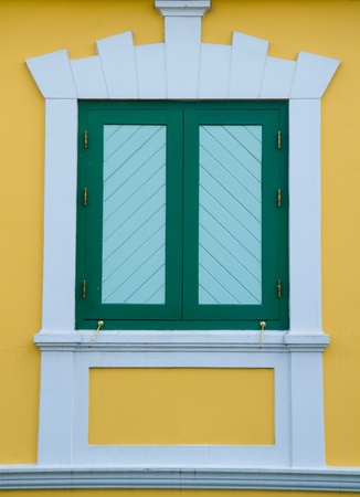 Green window Yellow wallpaper. photo
