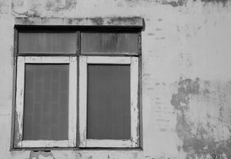 vintage window on the old wall photo