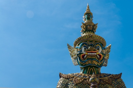 Giant statue in emerald temple with blue sky  photo