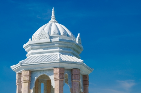 pavillion: Roof of white pavillion with blue sky.