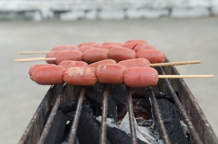 Grill sausage with hot coal. photo