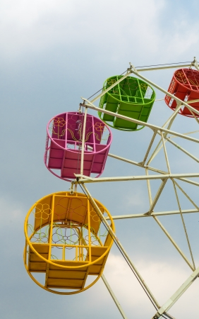 Colorful swing with the sky. photo